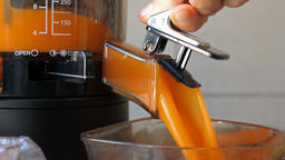 Process of extracting fresh juice from carrot. Closeup shot Live Action
