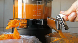 Slow juicer is making fresh carrot juice Live Action