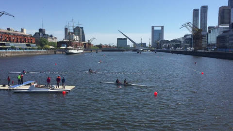 Row boats and kayaks traffic in harbor lanes for the Buenos Aires Youth Olympic 영상물