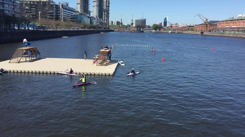 Kayaking practice for Buenos Aires Youth Olympic games near harbor platform Footage
