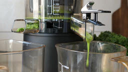 Process of extracting fresh juice from kale, apple and... Stock Video Footage