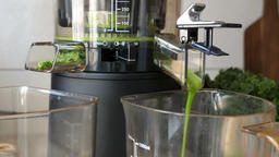 Process of extracting fresh juice from kale, apple and fresh mint 2 Footage