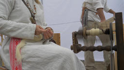 Woman is spinning wool on a spinning wheel 8 Live Action