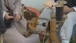 Woman is spinning wool on a spinning wheel 5 Live Action