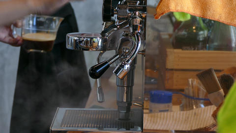 Coffee machine brewing hot fresh coffee Live Action