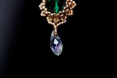 handmade jewelry made of beads in macro. earrings from white beads. earrings Photo