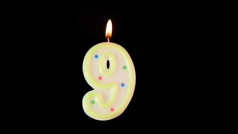 Candle number 9 burning - birthday! Transparent background Footage