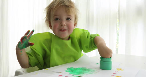 Child draws finger-type paints Footage