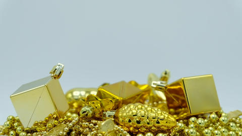 Golden Christmas decoration close up rotating on white background Footage