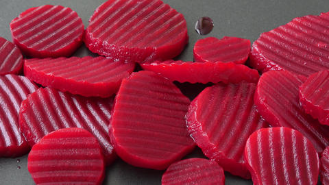 Sliced boiled beetroot on black background Live Action