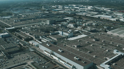 Aerial view of a modern car factory or automobile plant Footage