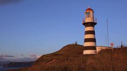 Striped old building of Petropavlovsky Lighthouse on Pacific Coast of Kamchatka GIF