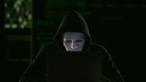Hacker in mask and gloves breaking government servers, threat of terrorism Live Action