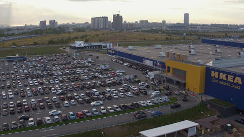 aerial view parking filled with cars near modern IKEA center Footage