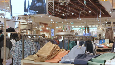 fashion store with stylish clothes selection on racks GIF