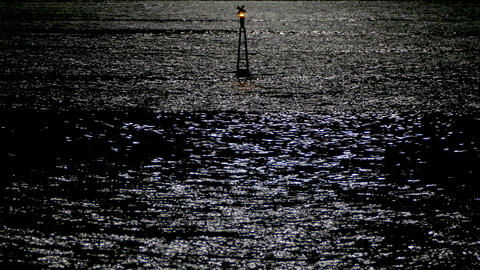 Reflection of moonlight sea with a lighted buoy Live Action
