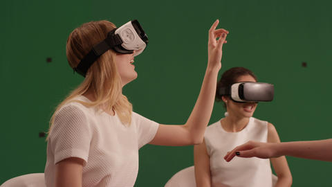 smiling girls in virtual reality glasses play in video games 영상물