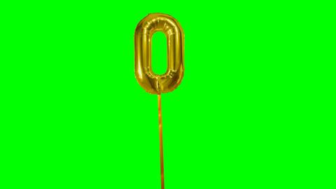 Number 0 zero helium golden balloon floating on green screen ビデオ