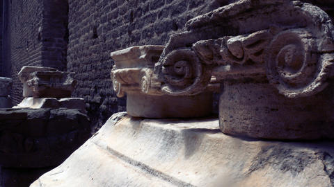 tracking shot on the remains of capitals of ionic column capitals Footage