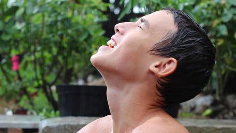 Young Handsome Caucasian Teen Happy Cheerful Rain Rainy Summer Day ビデオ