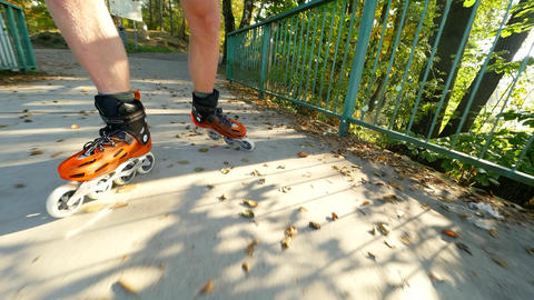 Close up of inline roller skater legs. Skating in hard shell hi-tech skates on Footage