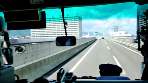 Shot from inside the tour bus along the street & high way of Japan Footage