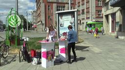 OLOMOUC, CZECH REPUBLIC, JULY 5, 2018: Young women offer for sale perfume Footage
