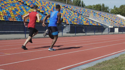 Two competitors running middle-distance race to determine title of champion Live Action