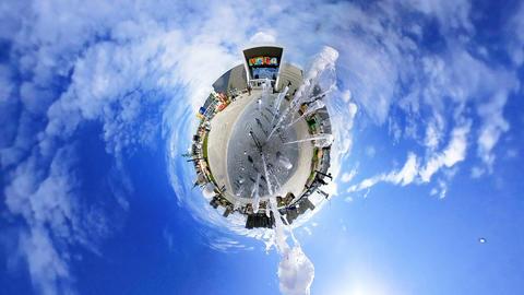rabbit hole planet fountain sprays high jets near mall Footage