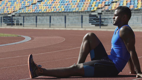Sportsman resting on racetrack observing training of competitors, exercising Footage