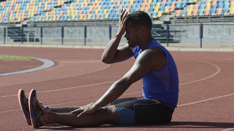 Latin athlete wiping sweat from forehead and rubbing... Stock Video Footage