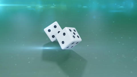 Two white dices in motion against a green background Stock Video Footage