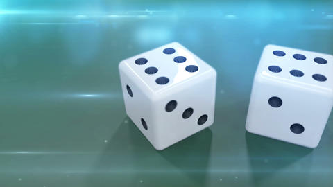 Two White Dices In Motion Against A Green Background stock footage