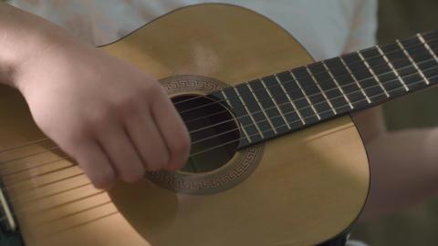 Human hand plays guitar closeup ライブ動画