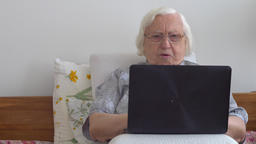 Funny old lady with a laptop computer Footage