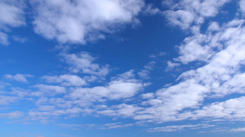 Bright blue sky and white clouds floating away. Clouds flying in clear blue sky Footage