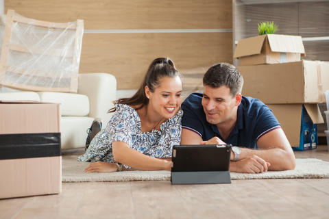 Young couple feeling happy in their new house フォト