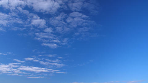 Clear sky and white clouds flying in heaven. Fluffy clouds floating in blue sky Footage
