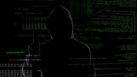 Man in hood push button on virtual screen with scripts, anonymous cyber attack Live-Action