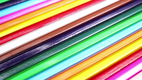 Wooden pencils rotating colorful rainbow background Footage