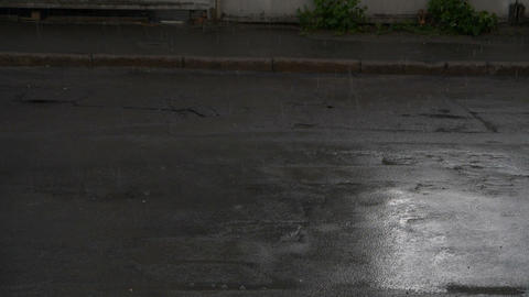 Car rides on the road in rainy weather in slow motion GIF
