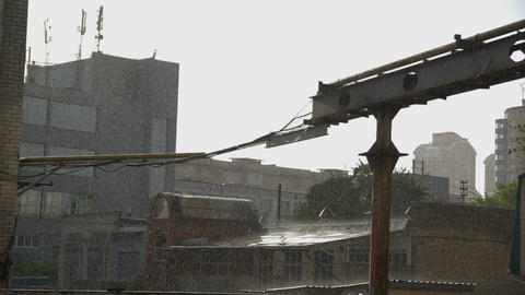 Industrial buildings in the rain in slow motion GIF