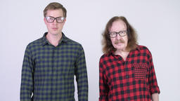 Senior hipster man and young handsome hipster man together Footage
