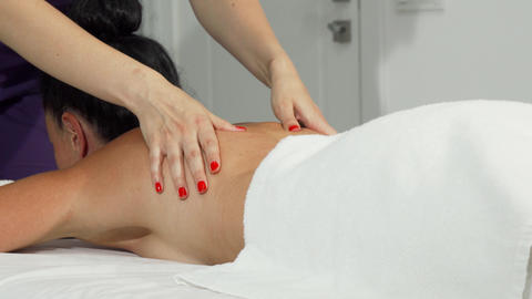 Woman getting soothing massage at the hands of a professional masseuse Live Action