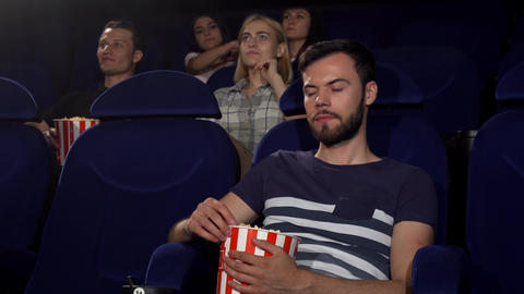 Man talking on his phone at the movie theatre Footage