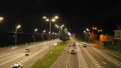 Multiband highway in big city with going cars in night. Cars drive on highway Footage