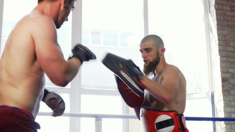 Rear view shot of a strong muscular mma fighter training with the padman Footage