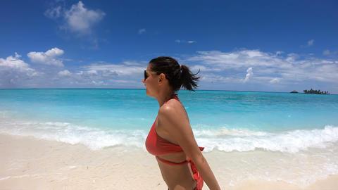 [alt video] Slow Motion Happy Girl Runs on the Coast of Maldives