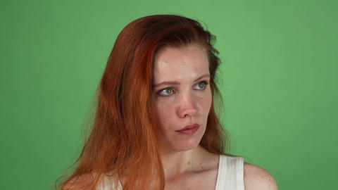 Angry red haired woman on green chromakey Live Action