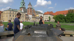 Tourists are watching the model of Wawel castle Footage
